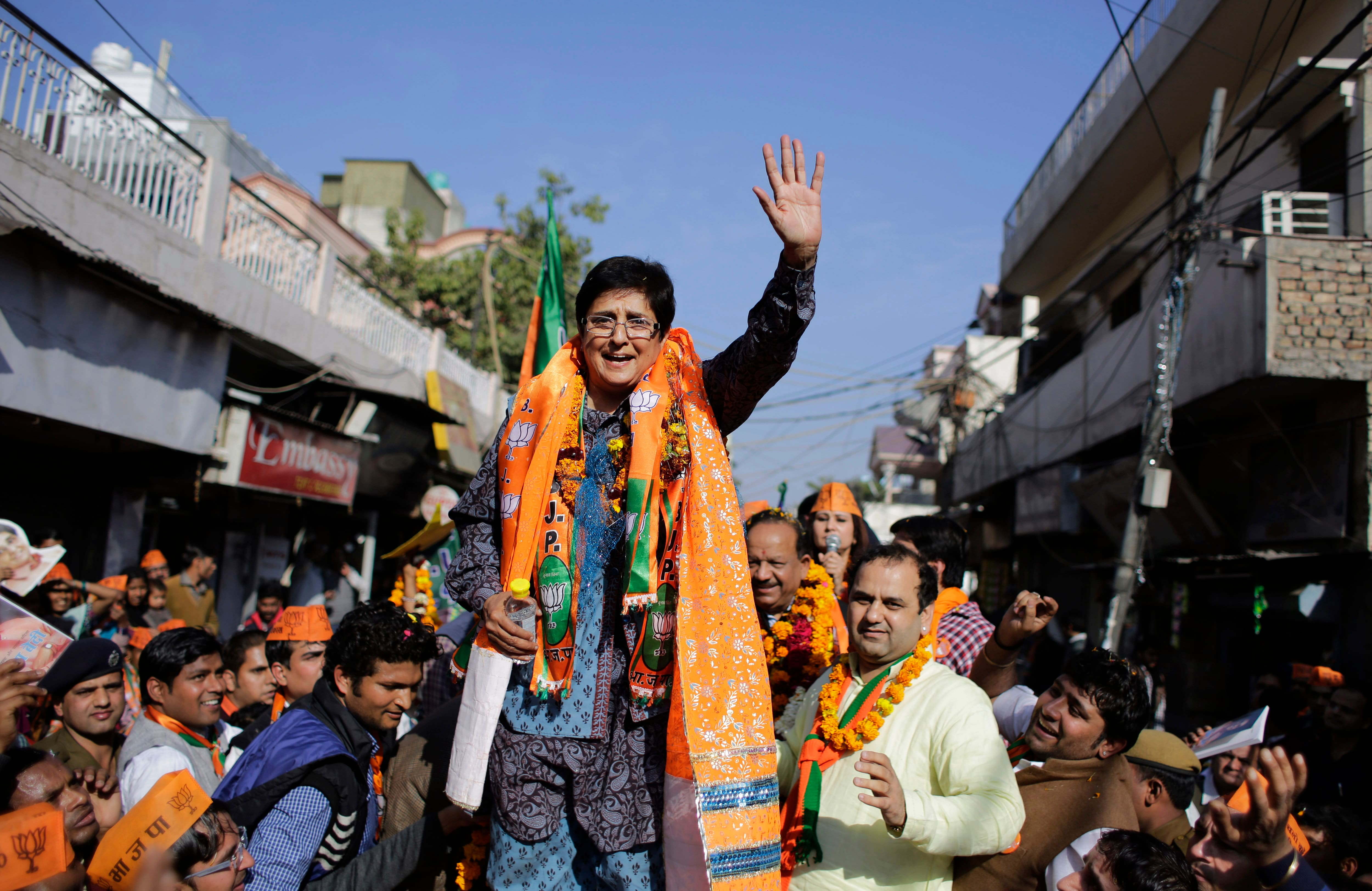 Bharatiya Janata Party (BJP) chief ministerial candidate Kiran Bedi waves to supporters during an election campaign rally ahead of Delhi state election in New Delhi.