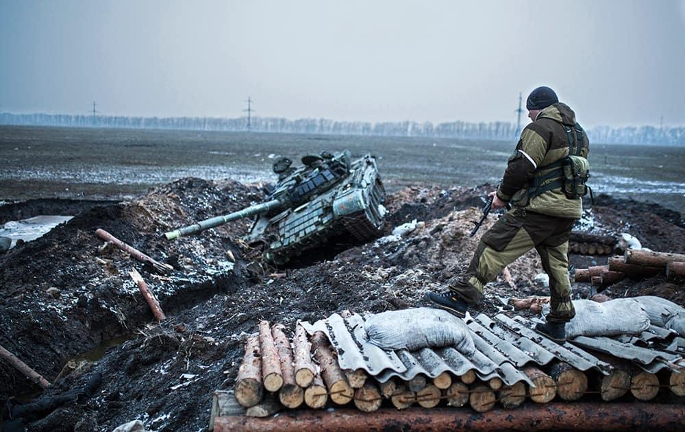 A pro-Russian rebel guards captured former Ukrainian Army checkpoint outside Vuhlehirsk, Donetsk region, eastern Ukraine.