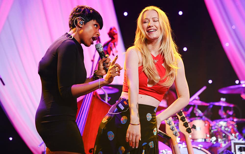 Singers Jennifer Hudson and Iggy Azalea perform at the Clive Davis Pre-Grammy Gala Press Day at the Beverly Hilton hotel, in Beverly Hills, Calif.