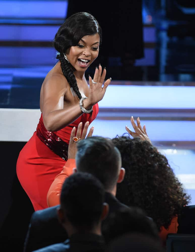 "Taraji P. Henson, high-fives Oprah Winfrey after winning the award for outstanding actress in a motion picture for ""No Good Deed"" at the 46th NAACP Image Awards at the Pasadena Civic Auditorium on Friday, Feb. 6, 2015, in Pasadena, Calif."