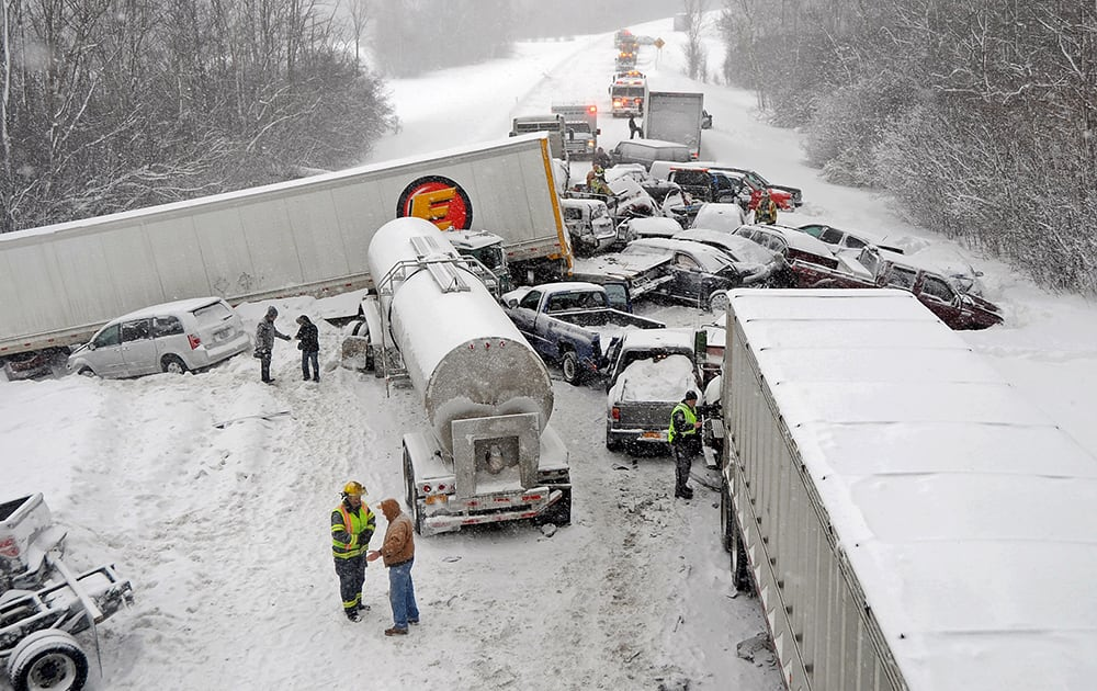 Cars and tracker trailers are tangled up after a huge pileup along Interstate 81, near Sandy Creek, N.Y.  Troopers say the northbound lanes of the highway are closed from Exit 37 in the village of Sandy Creek to Exit 40 in the Town of Ellisburg due to heavy lake-effect snow.