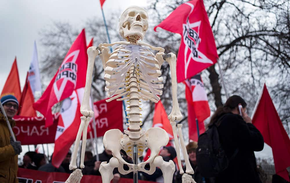 A plastic human skeleton is carried during the Empty Pockets march protesting impoverishment of the people in Moscow, Russia.