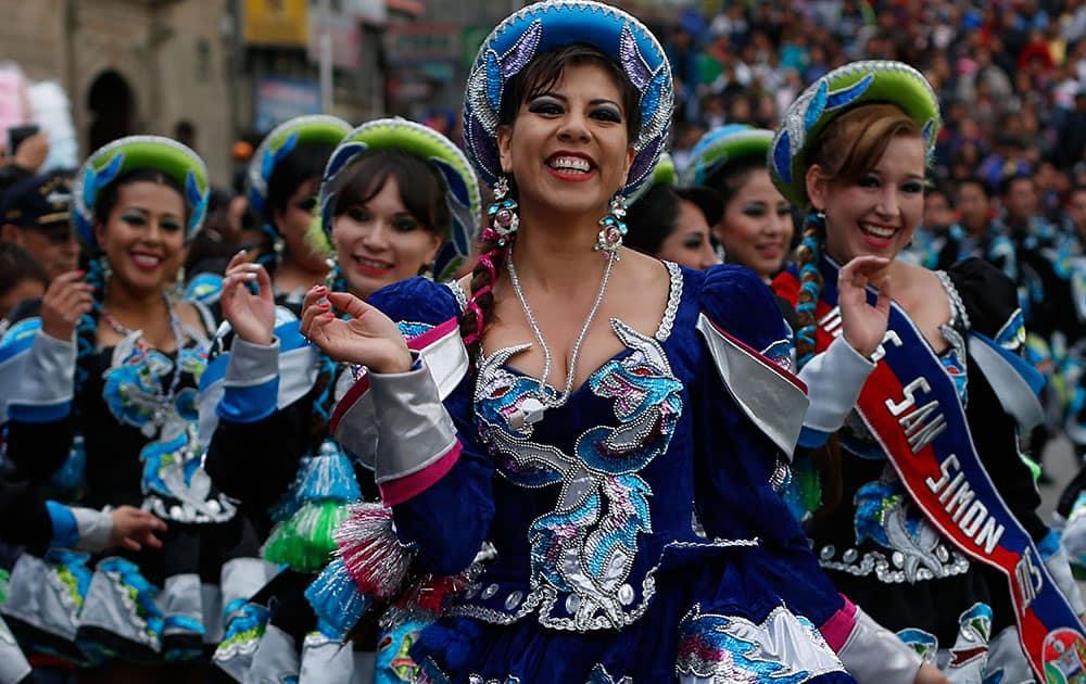 Women dance Caporal during the carnival in La Paz, Bolivia.