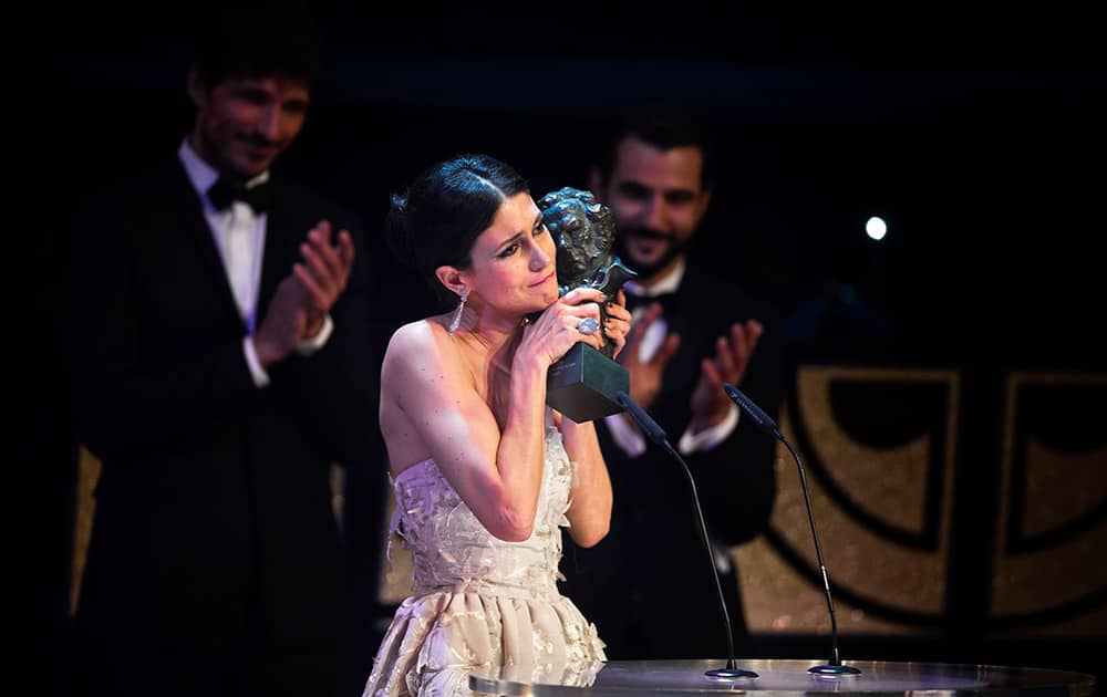 Spanish actress Nerea Barros holds her Goya trophy after winning the best new female actress award for her role in the film 'La Isla Minima' at the Goya Film Awards Ceremony in Madrid, Spain.