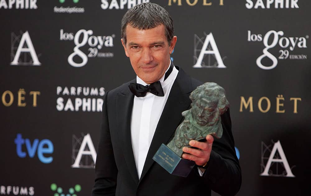 Spanish actor Antonio Banderas holds the trophy after winning the Goya of Honor at the Goya Film Awards Ceremony in Madrid, Spain.