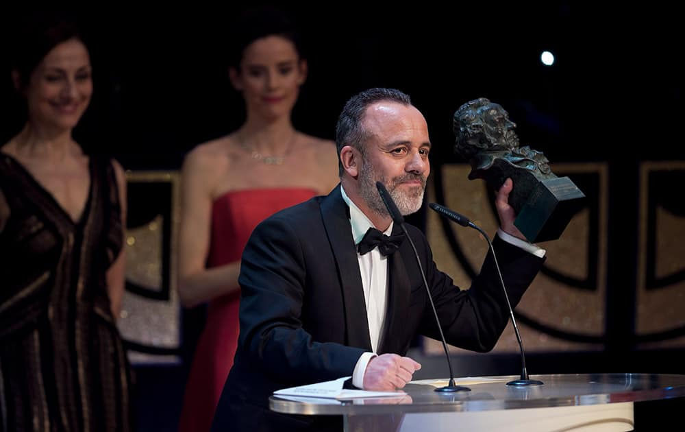 Spanish actor Javier Gutierrez holds his Goya award trophy after winning the best male actor award for his role in the film 'La isla Minima' at the Goya Film Awards Ceremony in Madrid, Spain.