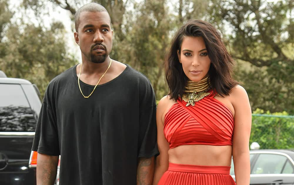 Kanye West and Kim Kardashian arrive at the Roc Nation Pre-Grammy Brunch at RocNation Offices in Beverly Hills, Calif.