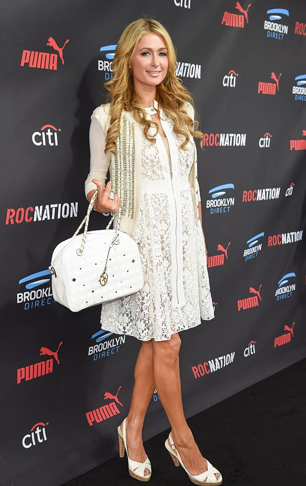 Paris Hilton arrives at the Roc Nation Pre-Grammy Brunch at RocNation Offices in Beverly Hills, Calif.