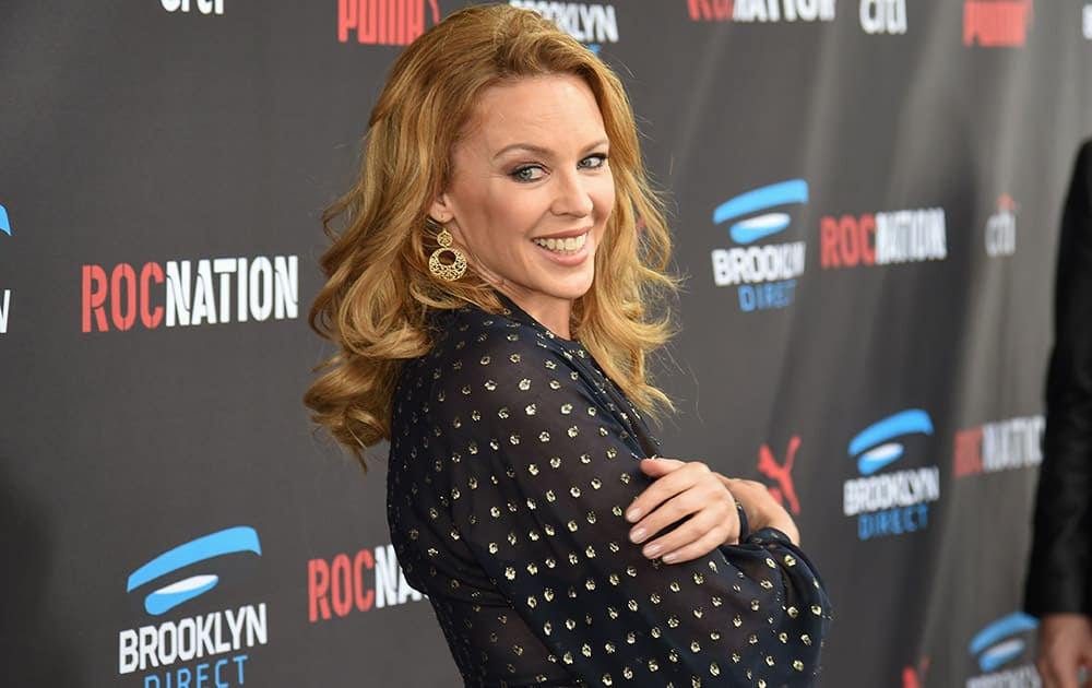 Kylie Minogue arrives at the Roc Nation Pre-Grammy Brunch at RocNation Offices in Beverly Hills, Calif.