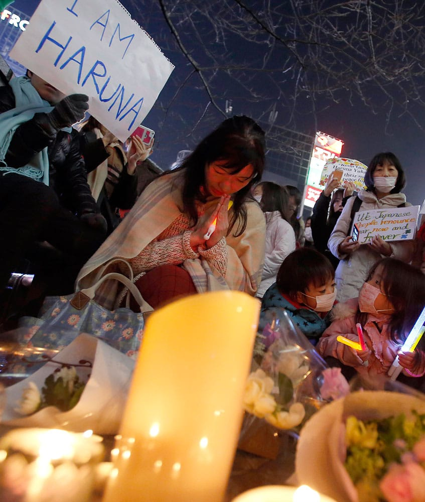 People gather to mourn two Japanese hostages, Kenji Goto and Haruna Yukawa, who were killed by the Islamic State group, in Tokyo