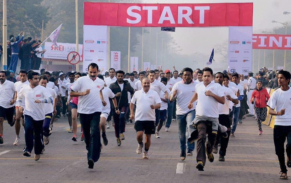 Participants run during the Kolkata Marathon 2015 in Kolkata.
