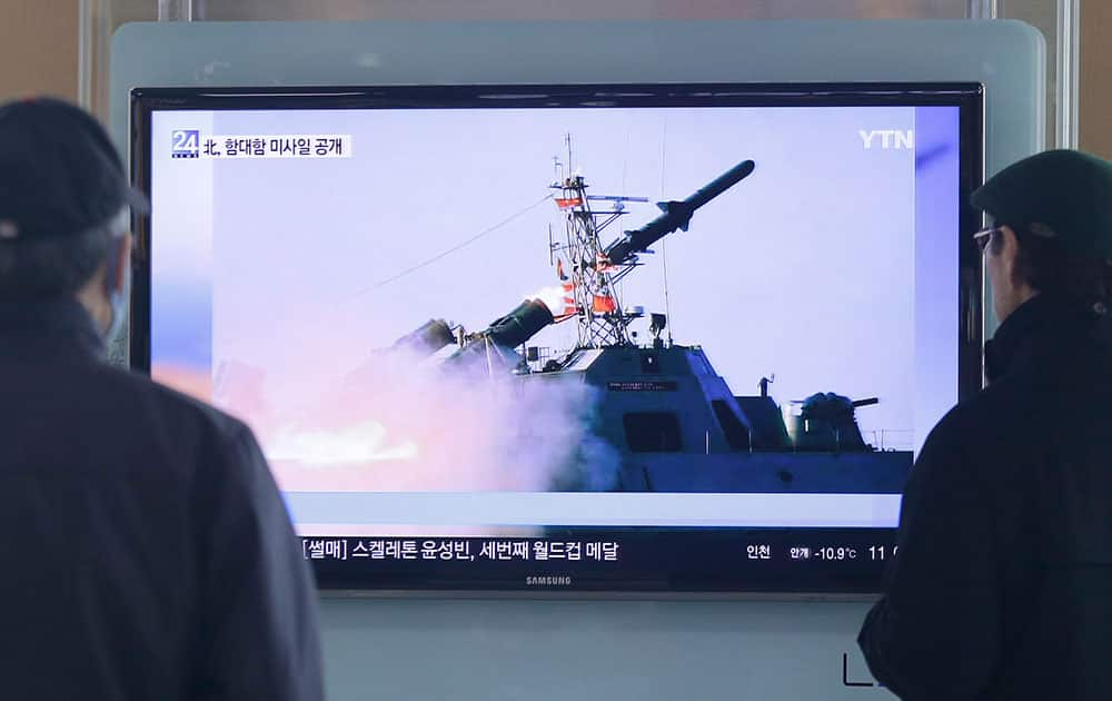 South Korean men watch a TV news program on the launch of North Korea's new anti-ship cruise missile, at Seoul train station in Seoul, South Korea.