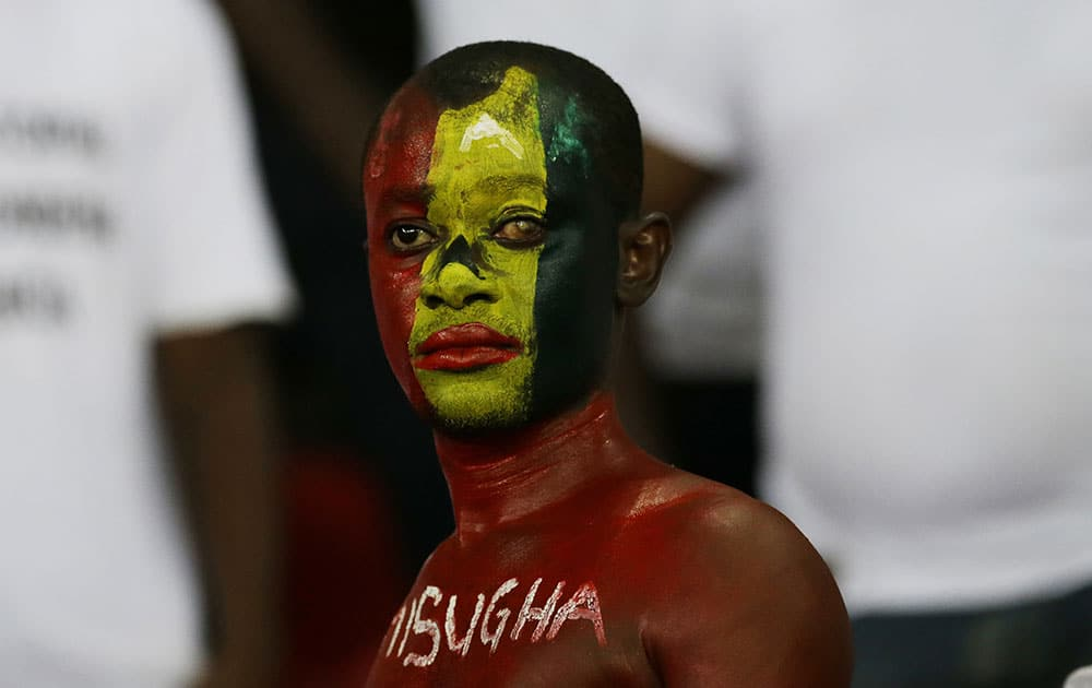 Ghana soccer fan with face painted in his country national colours reacts after his team lost their African Cup of Nations final soccer match to Ivory Coast in Bata, Equatorial Guinea.