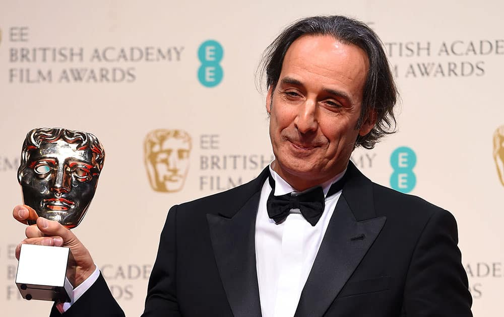 Alexandre Desplat, winner of Best Original Music for The Grand Budapest Hotel poses for photographers in the winners room, during the British Academy Film and Television Awards 2015.