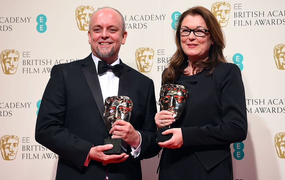 Mark Coulier, left, and Frances Hannon, winners of Best Make-Up and Hair for The Grand Budapest Hotel pose for photographers in the winners room, during the British Academy Film and Television Awards 2015.