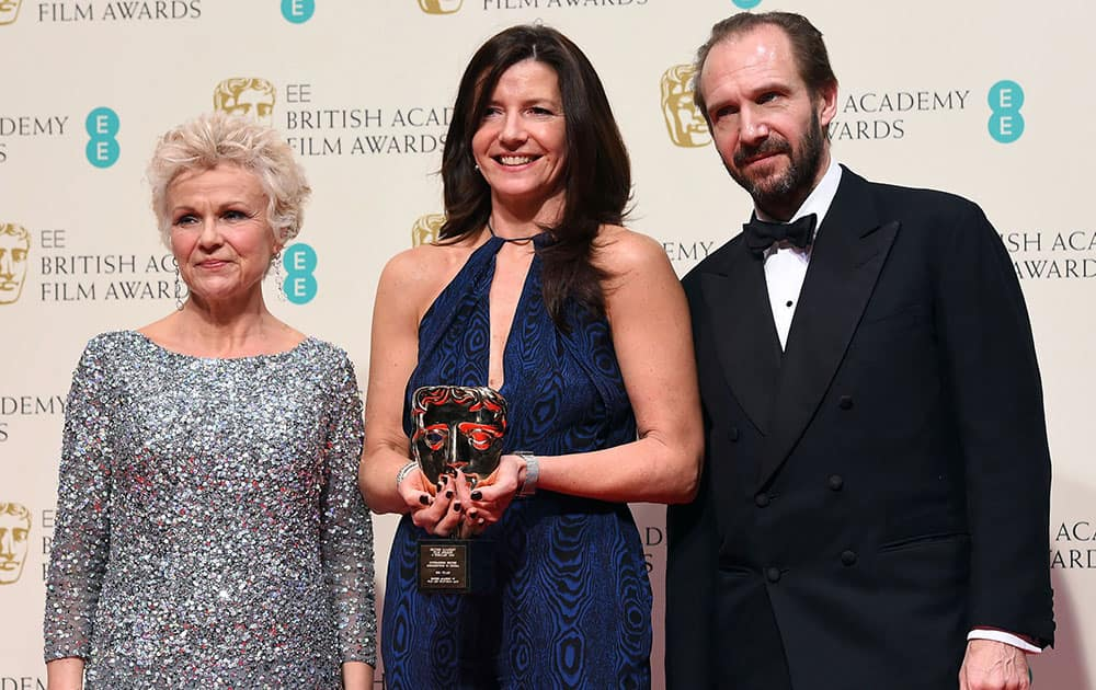Julie Walters, left and Ralph Fiennes, right, pose with Christine Langan, winner of Outstanding Contribution to British Film for The BBC, in the winners room, during the British Academy Film and Television Awards 2015.