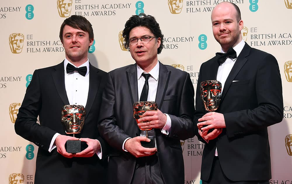 From left, Brian J. Falconer, Ronan Blaney and Michael Lennox, winners of the Best Short film, Boogaloo and Graham, pose for photographers in the winners room, during the British Academy Film and Television Awards 2015.