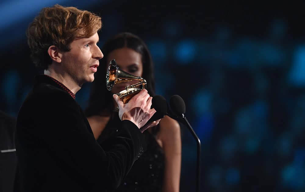 """Beck accepts the award for best rock album for """"Morning Phase"""" at the 57th annual Grammy Awards."""