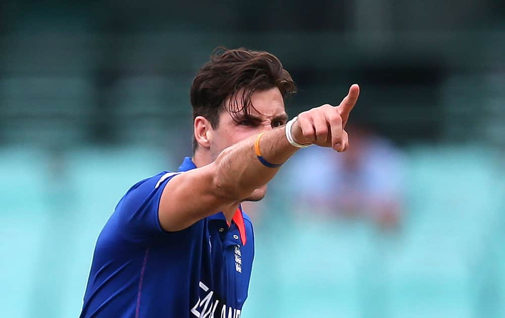 England bowler Steven Finn points as he makes an unsuccessful appeal for a wicket during their Cricket World Cup warm-up match against the West Indies in Sydney.
