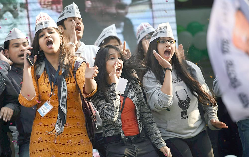 AAP volunteers celebrate the partys victory in the Delhi Assembly polls, at Patel Nagar in New Delhi.