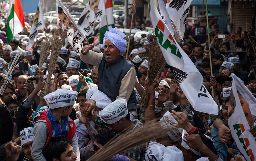 An elderly supporter of the Aam Aadmi Party celebrates his party's victory in New Delhi.