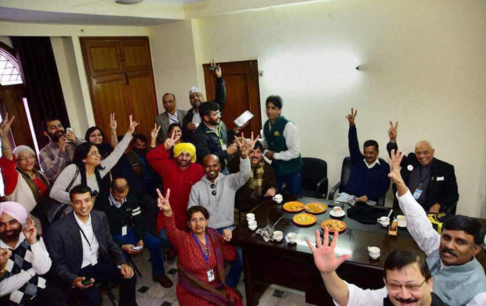 AAP convener Arvind Kejriwal and other party leaders celebrate their win in the Assembly polls, at party office in New Delhi.