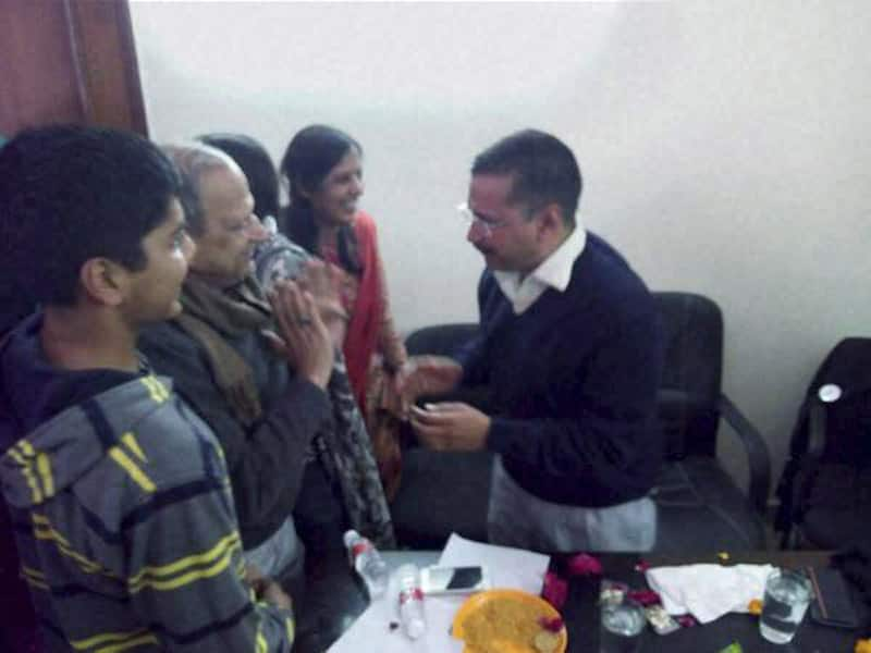 AAP convener Arvind Kejriwal celebrates with his family members after the early counting trends showed the partys win in the Assembly polls, at his residence in Kaushambi.