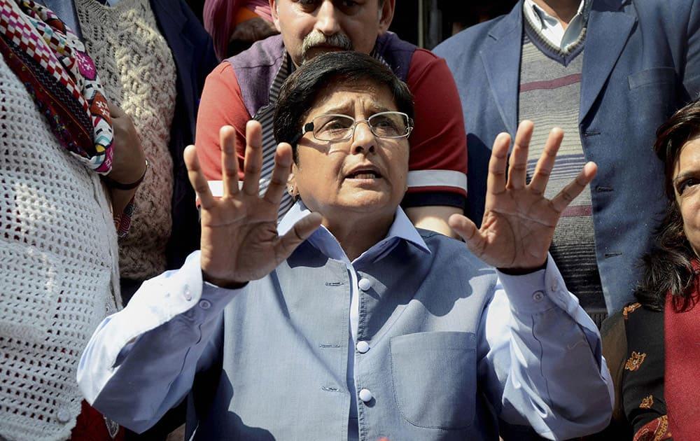 BJP leader Kiran Bedi addresses a press conference at her residence in New Delhi.