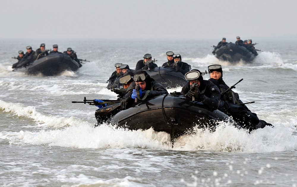 South Korean and United States marines ride on inflatable boats during a joint landing exercise to prepare for a possible North Korea's surprise attack in waters off Ganghwa Island, located inside of the civilian passage restriction line that separates the two Koreas since the Korean War, South Korea.
