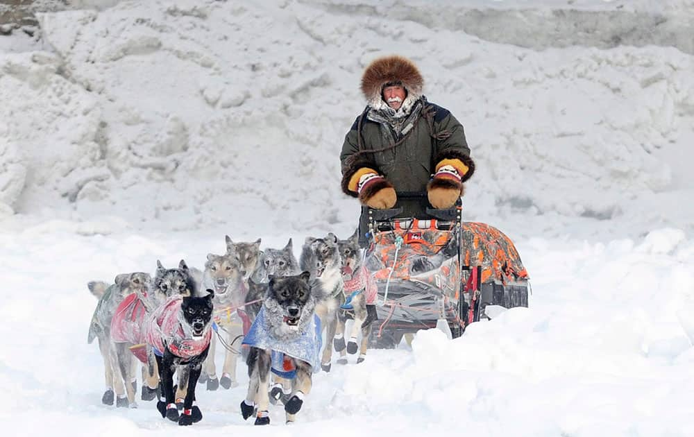 Denali Park, Alaska, musher Jeff King enters Carmacks, Yukon, by way of the Yukon River during the Yukon Quest International Sled Dog Race.