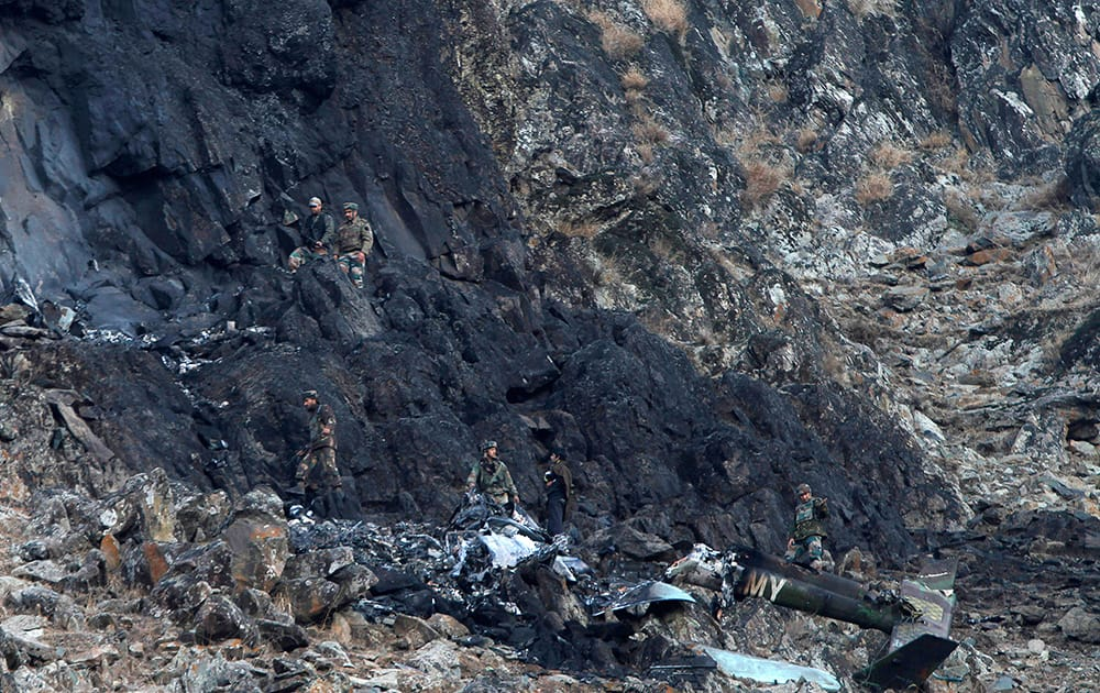 Army soldiers inspect the site of a helicopter crash on a hill in Bandipora district, some 38 kilometers north of Srinagar. Two army officers were killed when their helicopter crashed during a night flying training.