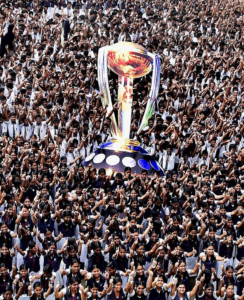 About 3,000 students of school display a mammoth model of the World Cricket Cup 2015 to cheer up the Indian team at the mega event, in Chennai.