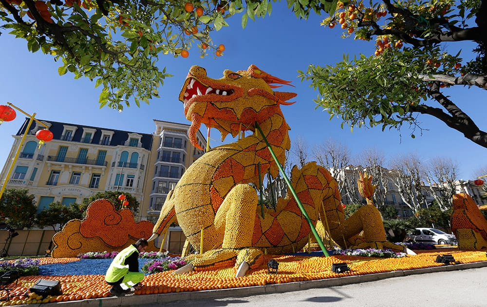 A worker sets up a Dragon made with lemons and oranges during the 82nd Lemon festival in Menton, southeastern France.