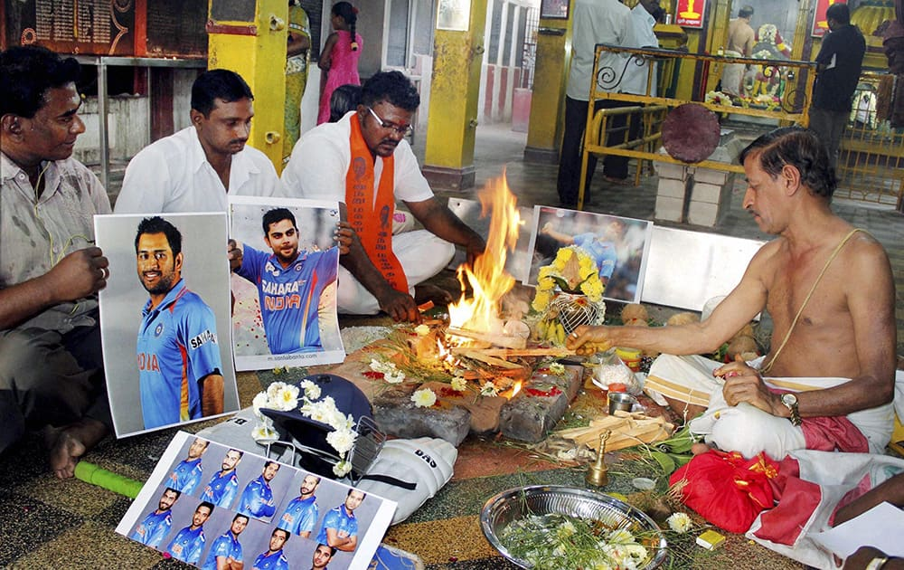Members of Hindu Makkal Katchi performing pooja with photographs of Indian cricketers for the teams win in upcoming ICC World Cup, at Lord Murugan Temple in Chennai.
