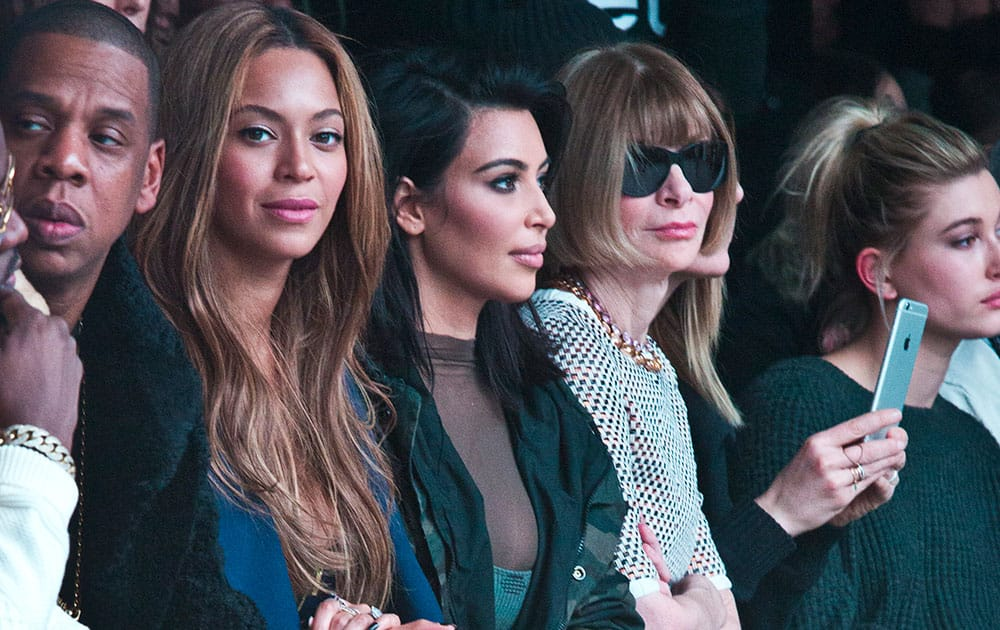 Jay-Z, from left, Beyonce, Kim Kardashian, and Anna Wintour appear at the showing of Kanye West's Yeezy Boost shoe line for Adidas, during Fashion Week in New York.