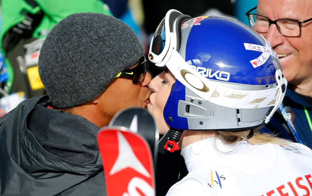 Tiger Woods kisses United States Lindsey Vonn during the women's giant slalom competition at the alpine skiing world championships.