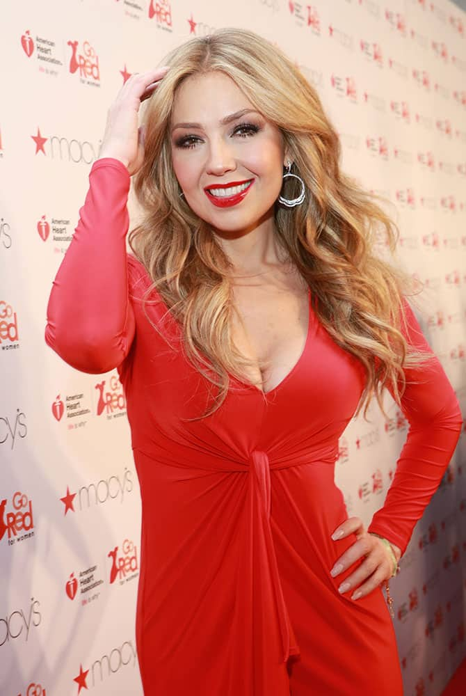 Thalia poses backstage at the Go Red For Women Red Dress Collection 2015 presented by Macy's during Mercedes-Benz Fashion Week Fall 2015.