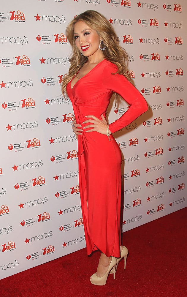 Thalia poses at the Go Red for Women Red Dress Fashion Show.