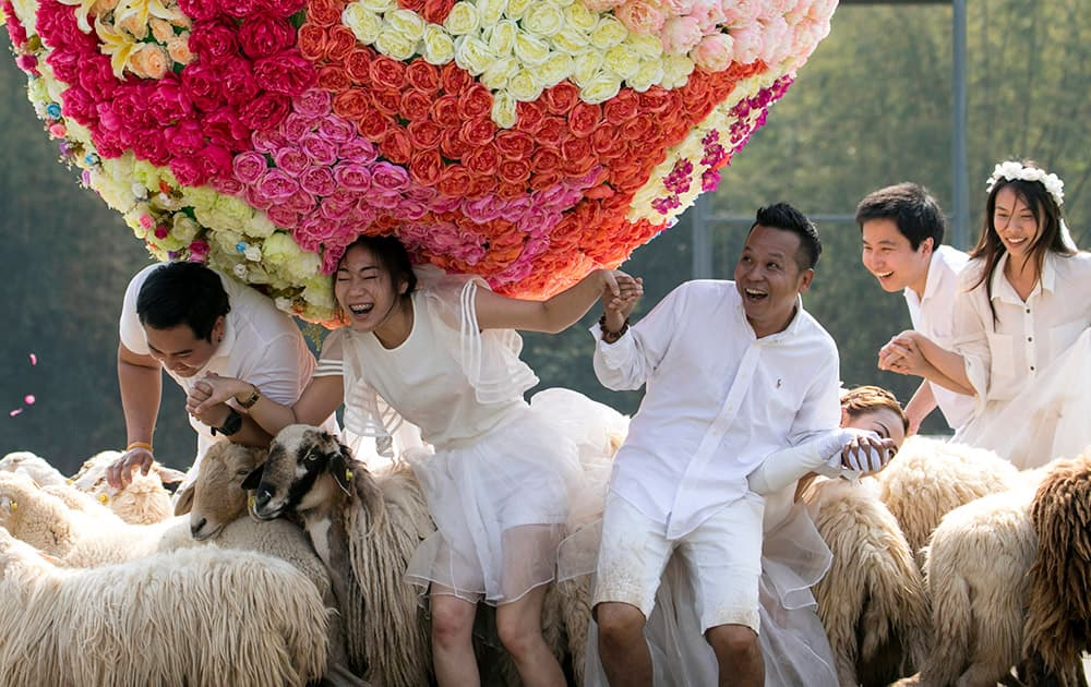 Three newlywed couples frolic at a resort in Ratchaburi province in western Thailand.