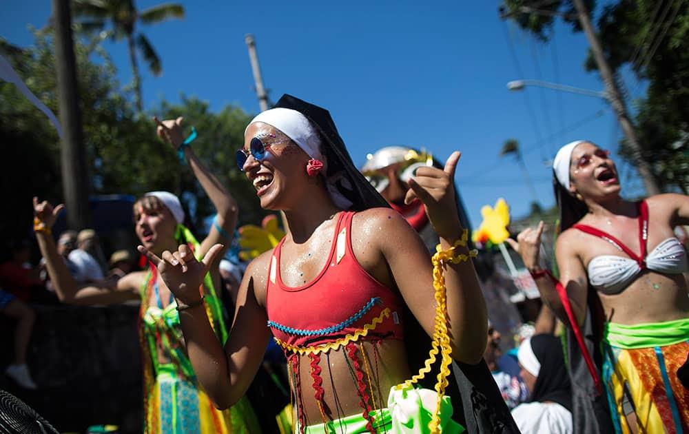 Revelers perform during the 'Carmelitas' carnival parade in Rio de Janeiro, Brazil.