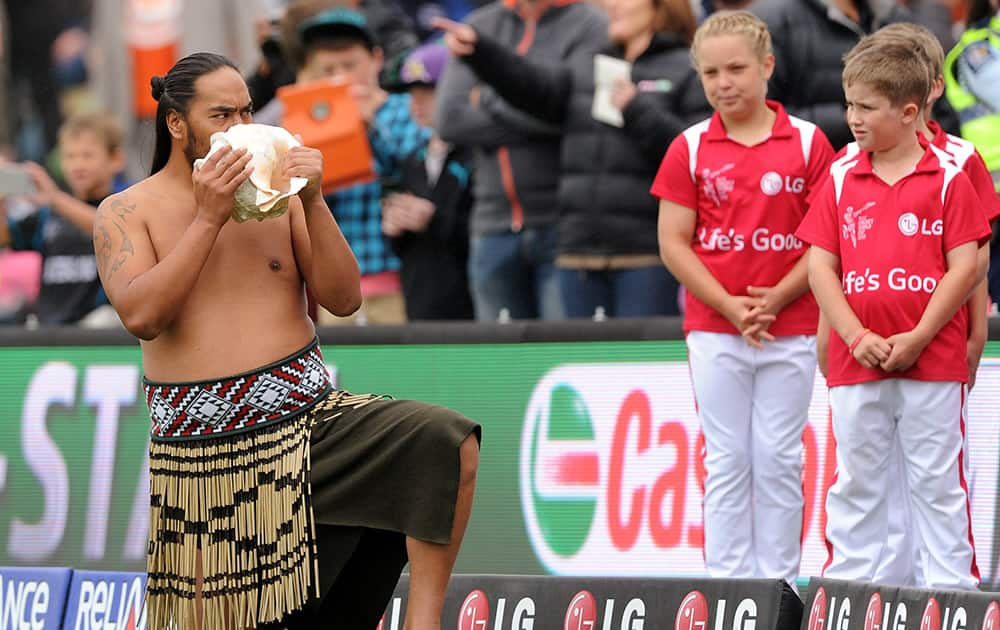 A New Zealand Maori man blows on a shell at the start of the opening match of the Cricket World Cup match between New Zealand and Sri Lanka at Christchurch, New Zealand.