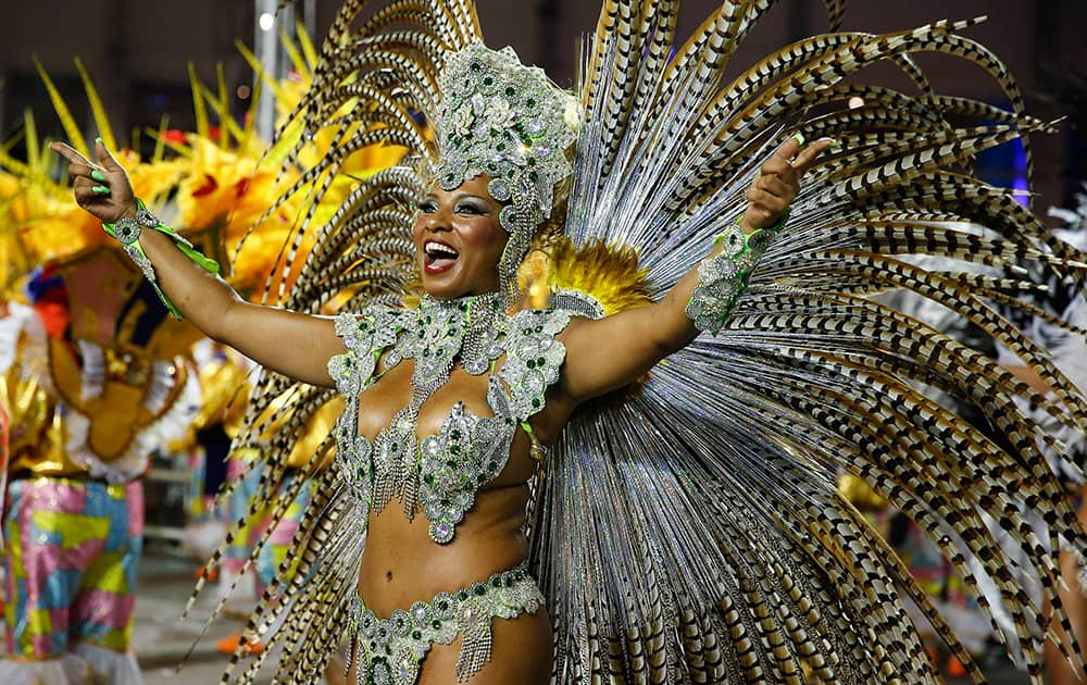 A dancer from the Academicos do Tucuruvi samba school performs during the Carnival parade at the Sambodromo in Sao Paulo, Brazil.