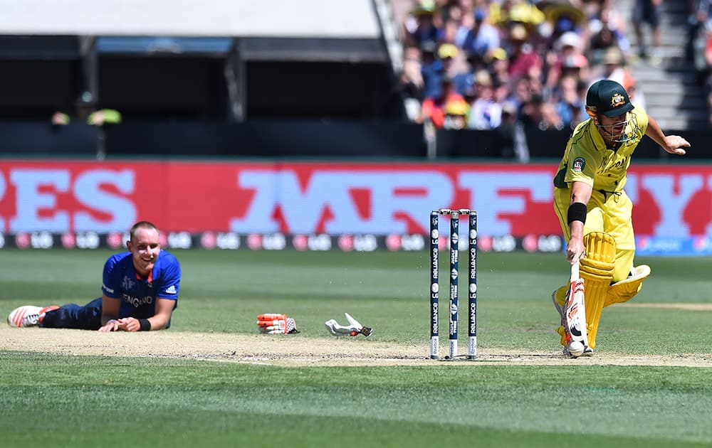 England bowler Stuart Broad, watches as Australia batsman David Warner runs to his crease after they collided midwicket during their cricket world cup pool A match in Melbourne.