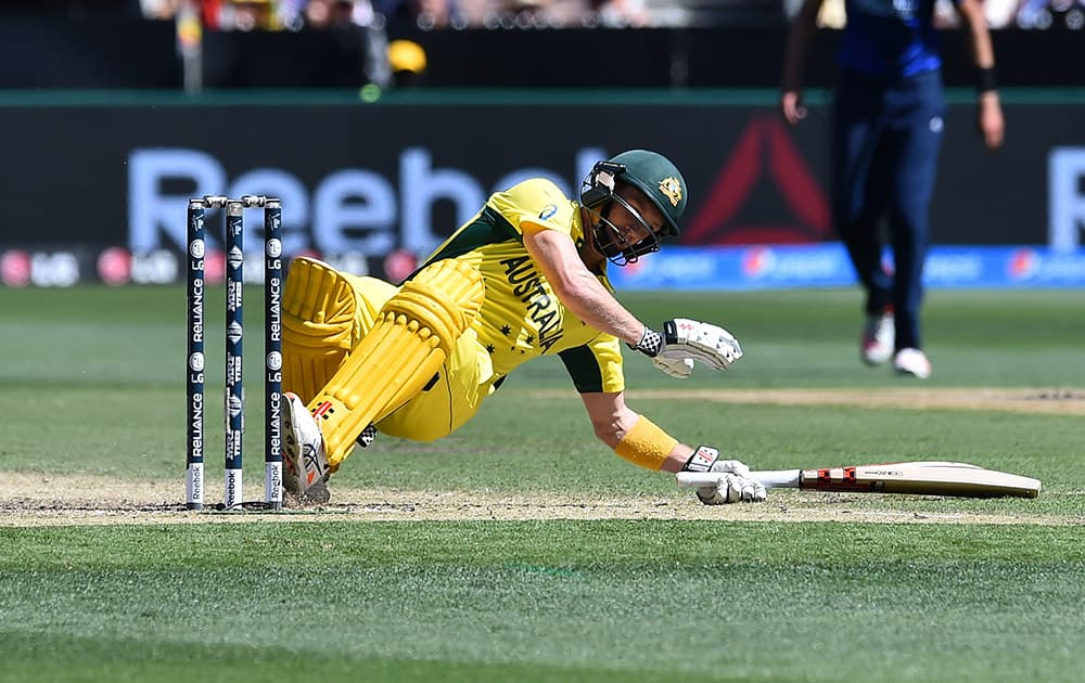 Australia captain George Bailey falls after he played a hook shot during their cricket world cup pool A match against England in Melbourne.