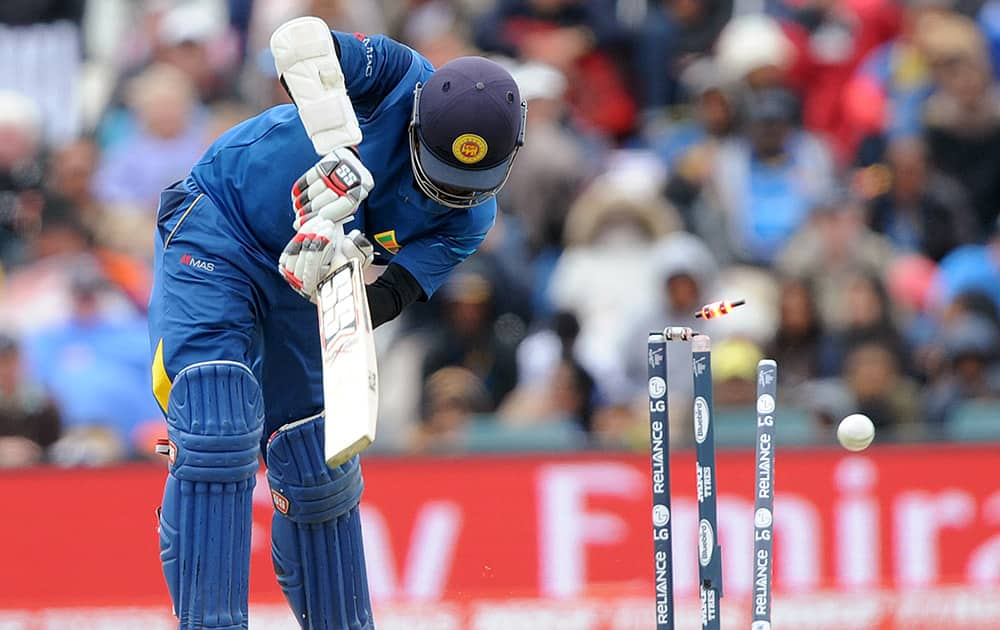 Sri Lanka's Lahiru Thirimanne is bowled out for 65 runs against New Zealand during the opening match of the Cricket World Cup at Christchurch, New Zealand.
