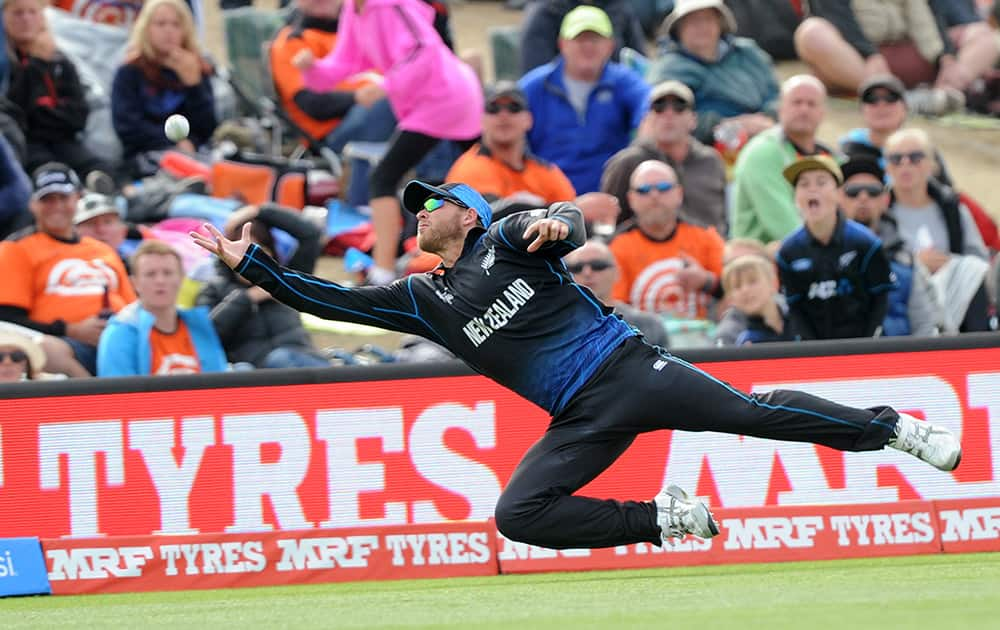 New Zealand's Corey Anderson dives in an attempt to catch out Sri Lanka's Jeevan Mendis during the opening match of the Cricket World Cup at Christchurch, New Zealand.