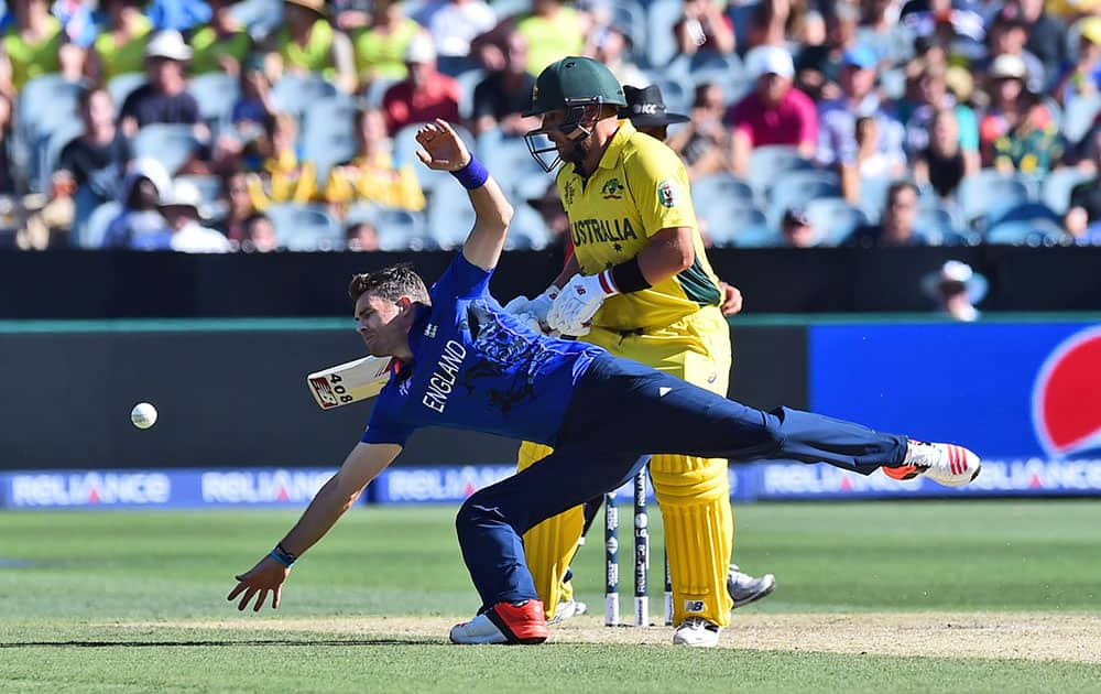 Australia's Aaron Finch watches as England's James Anderson dives to stop a ball during their Cricket World Cup pool A match in Melbourne, Australia, Saturday.