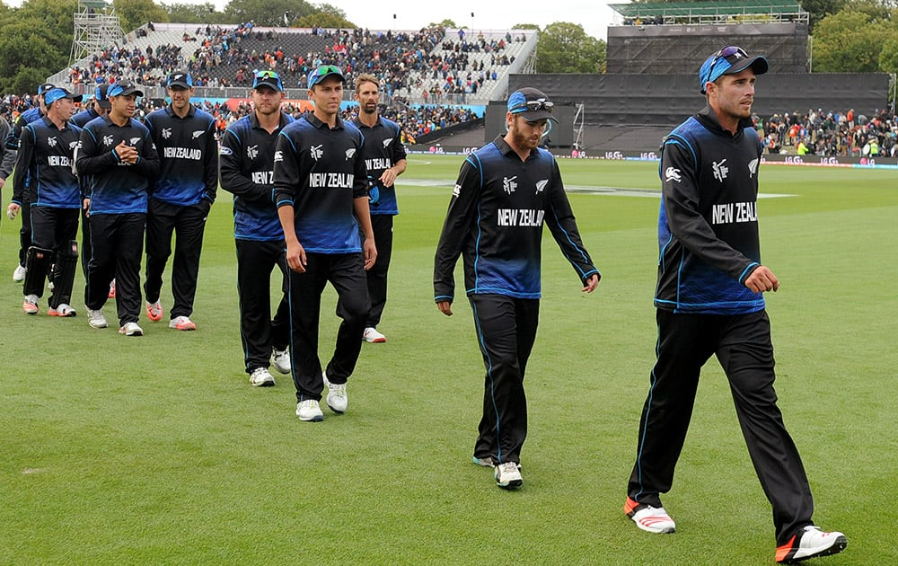 New Zealand's players leave the field after defeating Sri Lanka by 98 runs in the opening match of the Cricket World Cup at Christchurch, New Zealand.