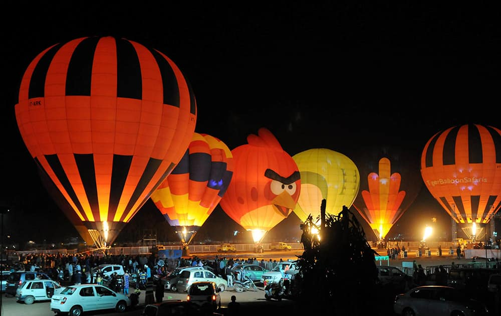 People enjoying International Hot Air Balloon Show at Lal Parade Ground in Bhopal on Friday evening.
