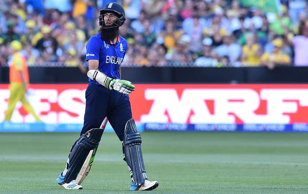 England's Moeen Ali walks off the field after his wicket was taken during their Cricket World Cup pool A match against Australia in Melbourne, Australia.